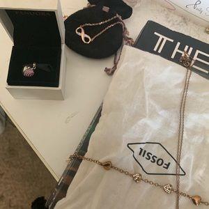 Rose gold bracelet, necklace, and pandora charm